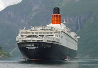 Photograph of the QE2 at anchor in Geiranger Fjord in June 2008