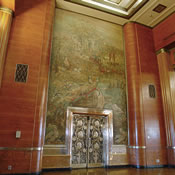 Painting by Philip Conrad and ornate bronze doors